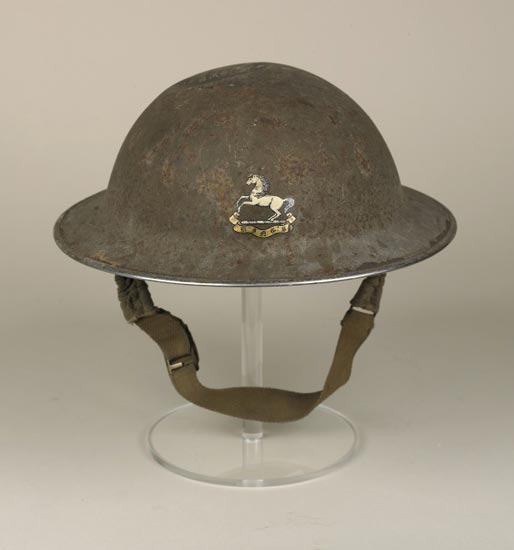 Soldier's helmet with King's Regiment badge