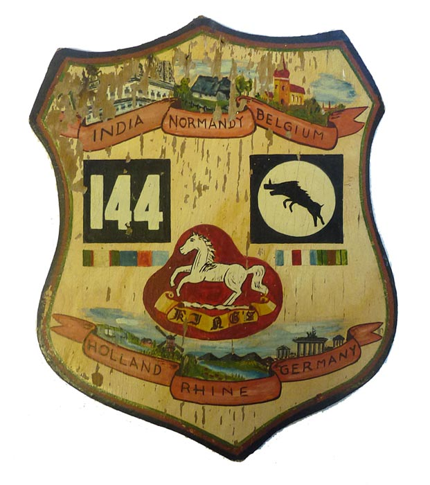 wooden shield with regimental logos