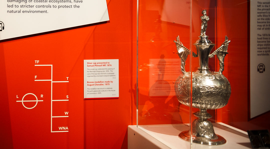silver trophy in museum display with Plimsoll Line on wall