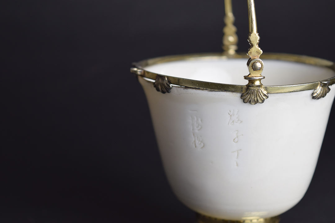 delicate porcelain cup with handle
