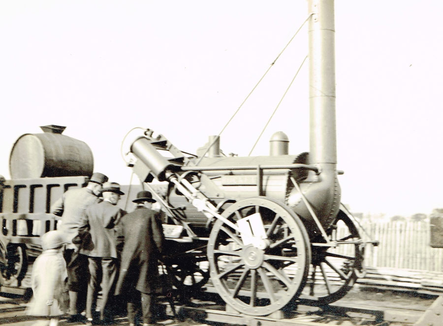 people looking at the Rocket, replica railway locomotive