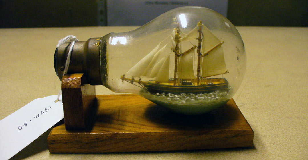 tint model sailing ship in a lightbulb