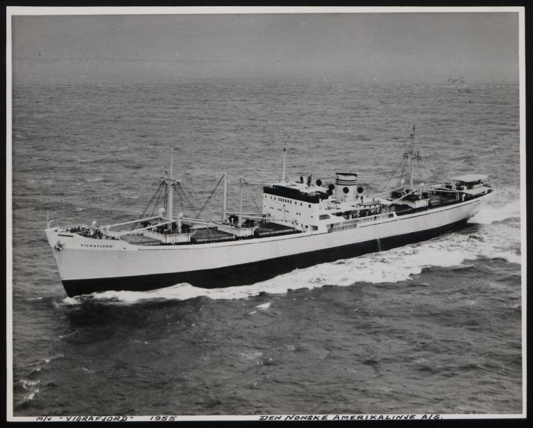 Photograph of Vigrafjord (r/n Ocean Tramp), Norwegian American Line card