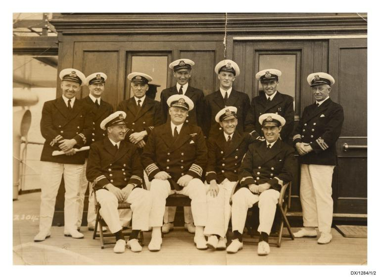 Photograph of Captain Coyle and officers of the Canadian Pacific ships, Montcalm and Duchess of Bedford. card