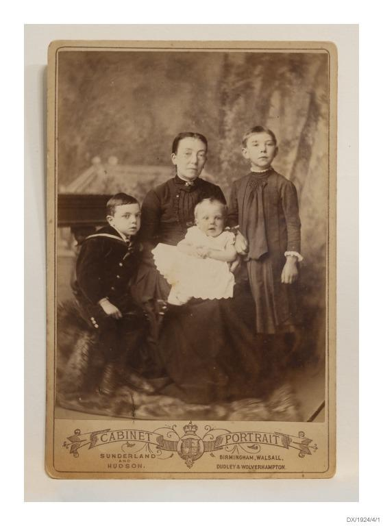 Photograph of Jane Dailey and her children. card