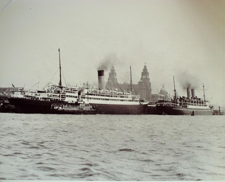 Photograph of 'A' Series Cunarder with Canadian Pacific vessel at Pier Head, Cunard Line card