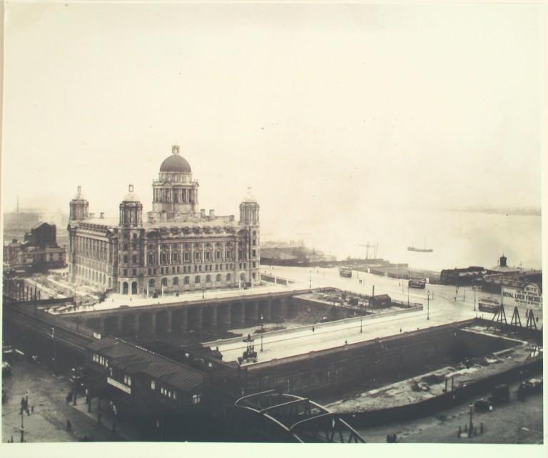 Photograph of Port of Liverpool Building seen across excavations for Cunard and Liver Buildings card
