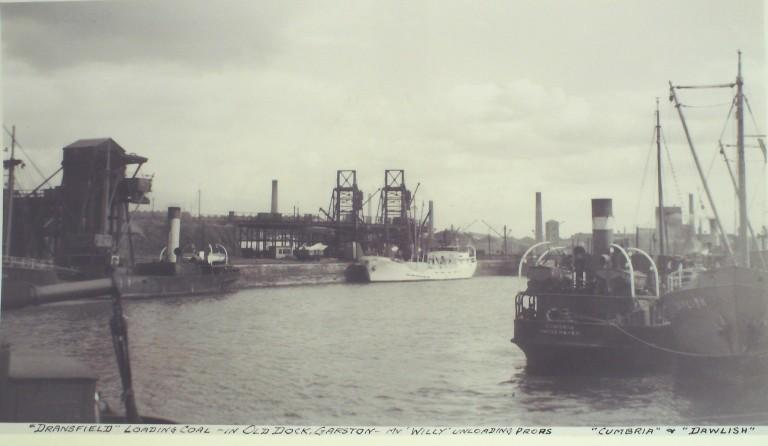 Photograph of Old Dock Garston with Dransfield loading coal and MV Willy unloading props card