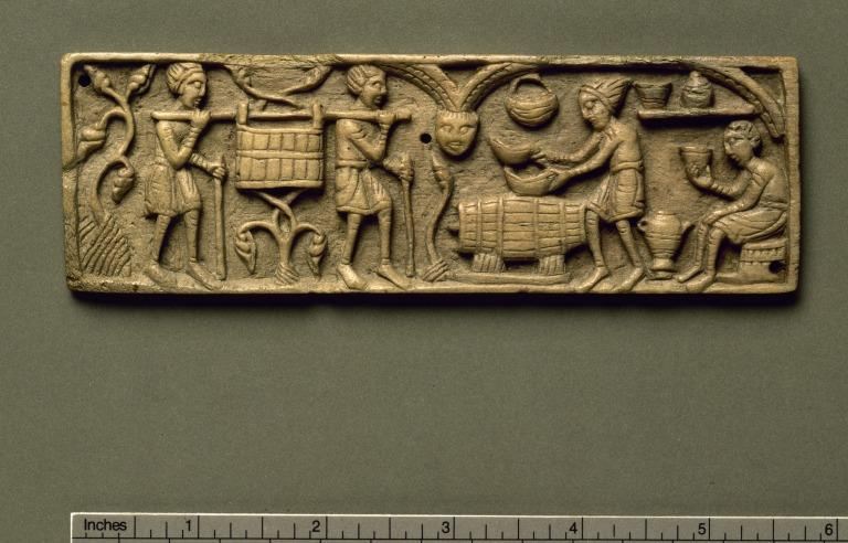 Carved panel showing vintage scenes card