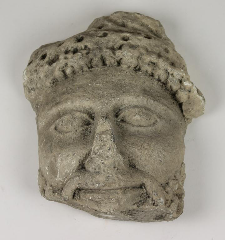 Fragment of a head from a votive statue card