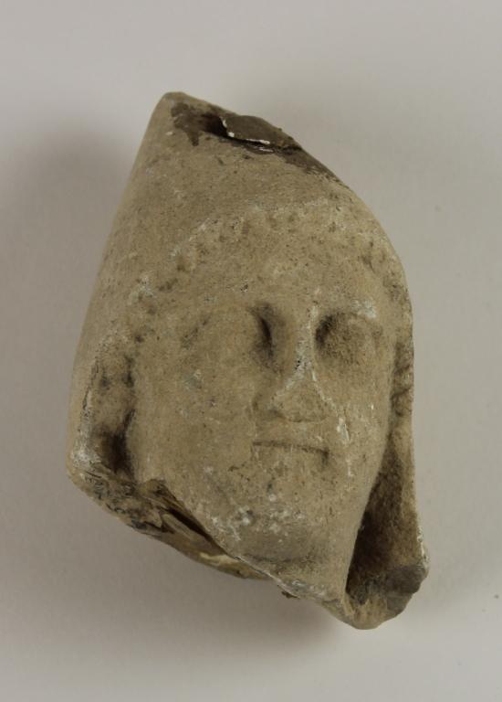 Female head from a votive statuette card