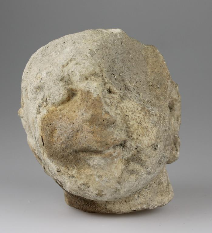 Head of a female votive statuette card