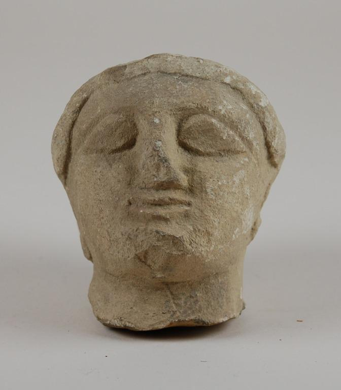 Head from a votive statuette card