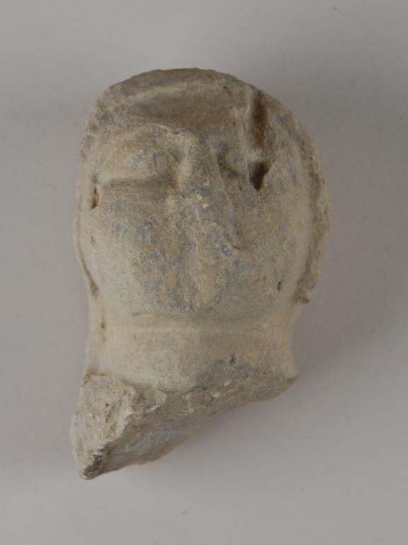 Head from a votive sculpture card