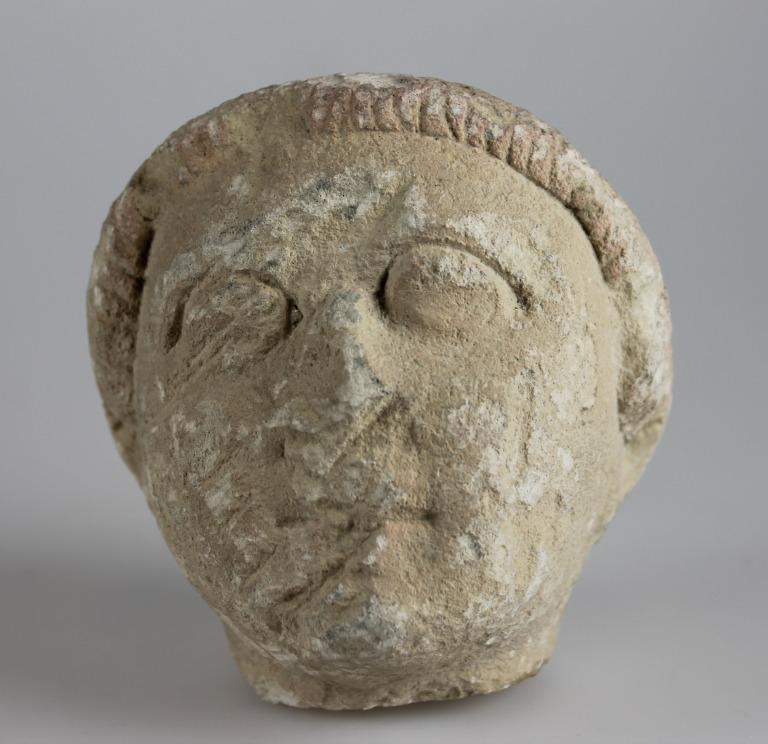 Head from a votive sculpture card