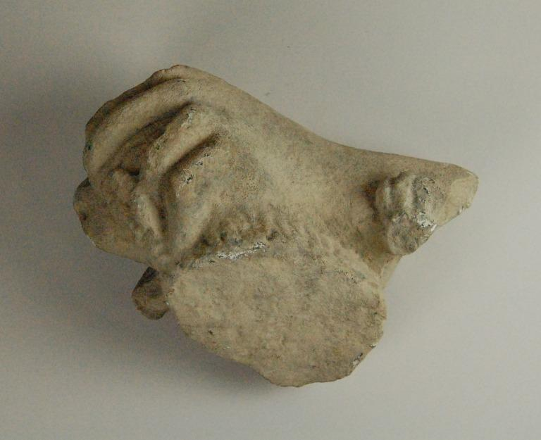 Hand from a statue on a head of a lion card