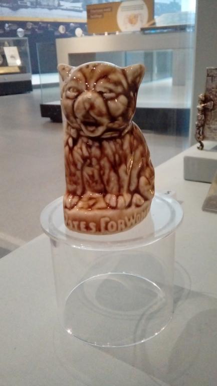 Porcelain cat figurine, 'Votes for Women' card